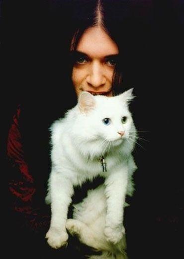 Brian Molko & a big furry white cat