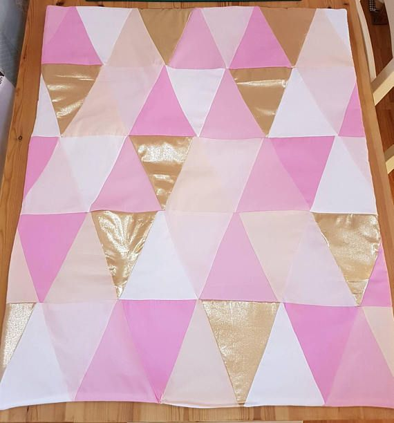 Beautiful pink gold and peach baby quilt. Handmade by myself. ❤ https://www.etsy.com/uk/listing/591617171/pink-baby-quilt-in-patched-triangles