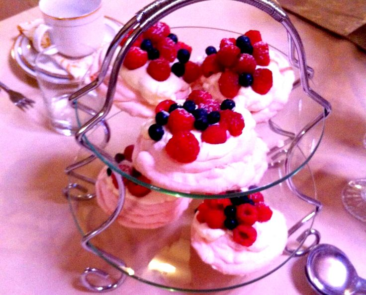 Swiss meringue topped with fresh berries