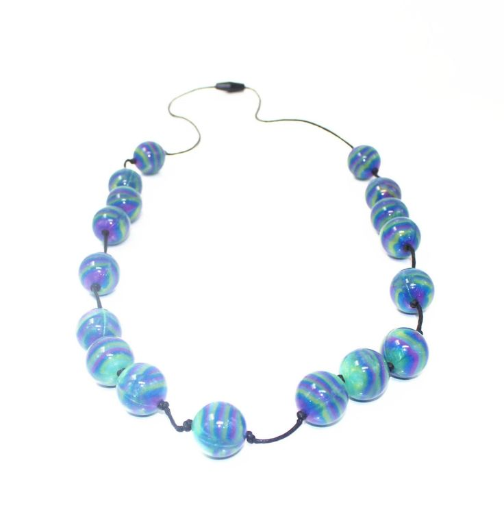 Stunning mixed beads of purple, blue and green...go on.. you know you want to! Match it with the Mermaid Bubba bangle.