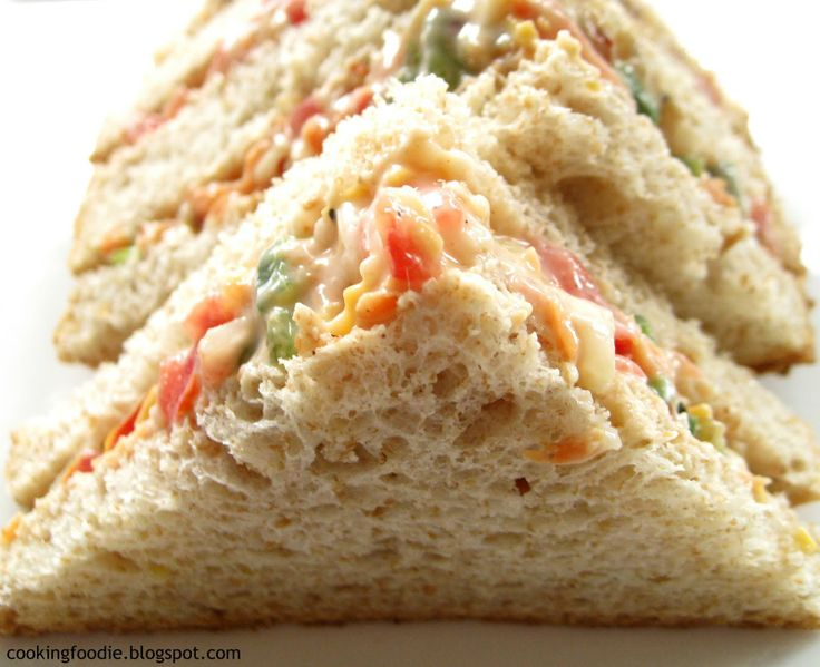 Russian Sandwich: 6 slices bread, 1.5C vegetable mix -diced onions, tomato, red and green peppers, grated carrots- 2 tbsp cheddar cheese, 1.5tbsp mayo, Salt and pepper