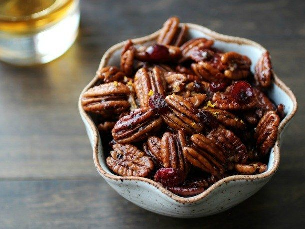 Bourbon Old Fashioned Glazed Pecans  After a few minutes toasting in a dry skillet, the pecans become fragrant and nutty. A toss in melted butter and a mix of brown sugar, salt, black pepper, and a touch of cayenne, then doused with bourbon and dotted with old-fashioned accoutrements of orange zest and cherries.
