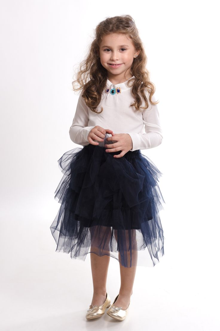 Cool outfit designed by Designers for Kids, a premium brand for children clothes inspired from fairytales and urban stories. Asymmetric tulle skirt and white blouse with swarovski elements and colorful bids embroidery, suitable for urban princess. You may purchase on www.designersforkids.ro