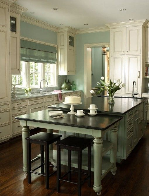 First pinner said--The antiqued white cabinets show up beautifully against the greenish blue walls. I like the dark countertops- so grounded. It's a calm beautiful space.---me too. |Pinned from PinTo for iPad|