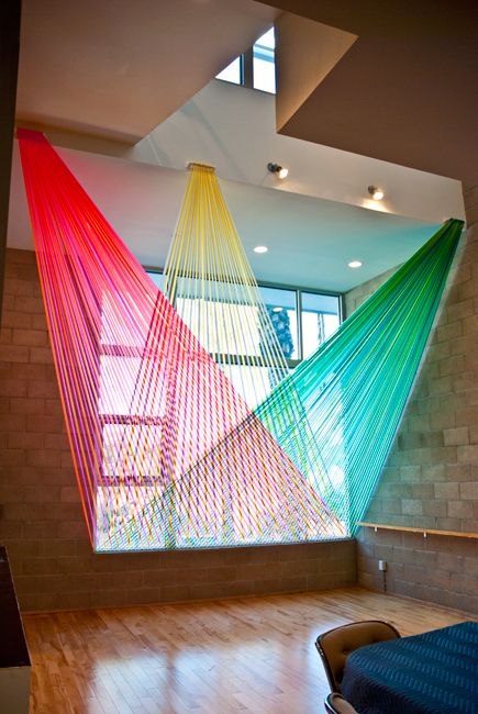 Megan Geckler >>> String Art Installations >>>  Installations are created with flagging tape (the plastic ribbon used on construction sites) and assembled by hand with help from assistants.