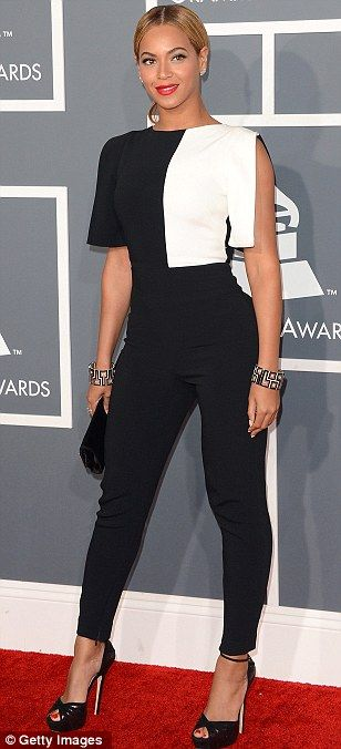 Beyoncé wore an Osman black crepe jumpsuit with white panel detailing, a Swarovski clutch, and Lorraine Schwartz jewelry.