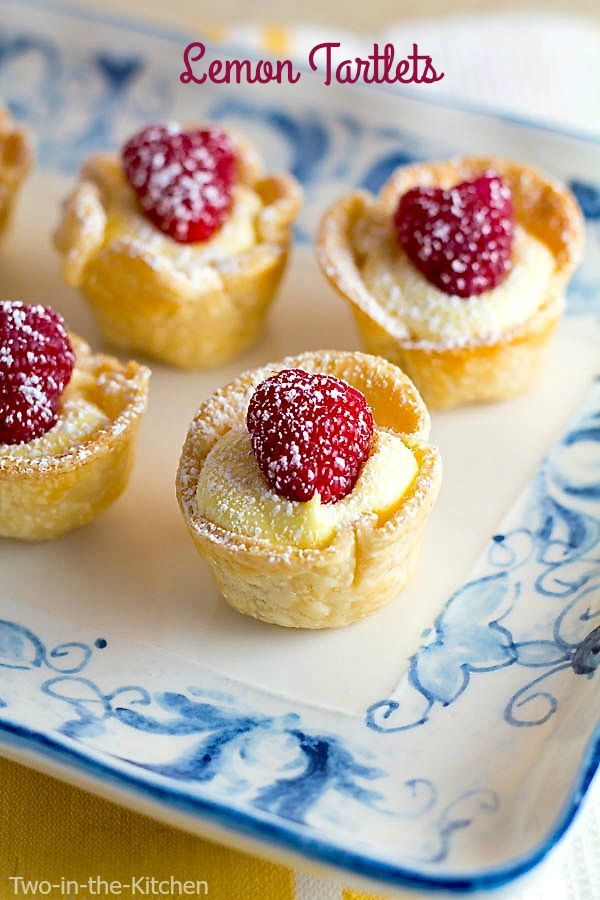 Lemon Tartlets 3 refrigerated pie crusts ( I used Pillsbury) 1 c. butter 1 1/4 c. sugar 1/2 c. freshly squeezed lemon juice 6 egg yolks 1 large egg 1 cup Cool Whip 35-36 raspberries (optional) powdered sugar for dusting (optional) Instructions