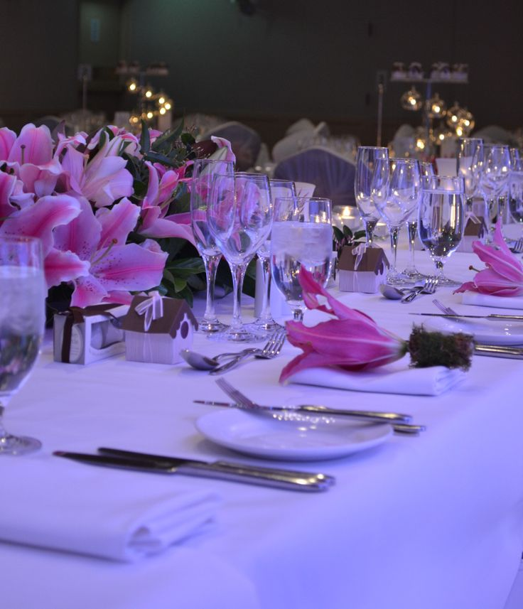 Pink lily bridal table arrangement. Styled by Greenstone Events.