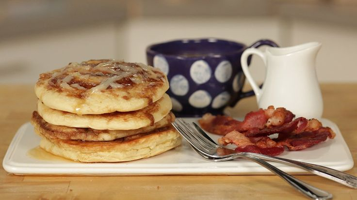 Cinnamon Roll Pancakes: The Best of Both Worlds: It's a tough decision: should you start a lazy Sunday with a plate of fluffy pancakes or ooey-gooey cinnamon rolls?