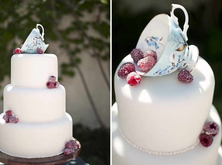 Tea party cake. So simple. Sugared berries spilling from a teacup on an all white cake.
