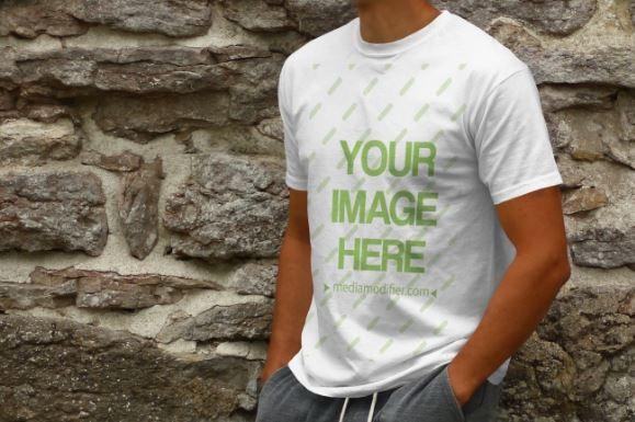 Young Man On Stone Wall Background T Shirt Mockup Generator Sharetemplates Shirt Mockup Clothing Mockup Tshirt Mockup