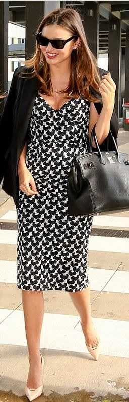 Who made Miranda Kerr's white print sweetheart dress, black sunglasses, tote handbag, and nude pumps that she wore on April 14, 2014?