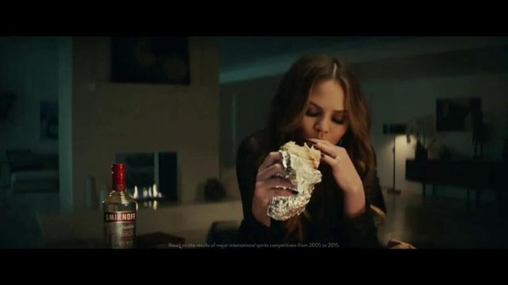 Chrissy Teigen could be too fancy to inhale a huge burrito while sipping Smirnoff Triple Distilled Vodka, but she isn't. Smirnoff could get pricey because it's been America's most awarded brand of vodka, but it doesn't.