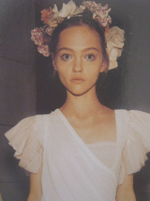 Best friends share floral wreaths. Because that's mine. She's totally just borrowing it. Because we're besties like that.  Backstage at Louis Vuitton SS07