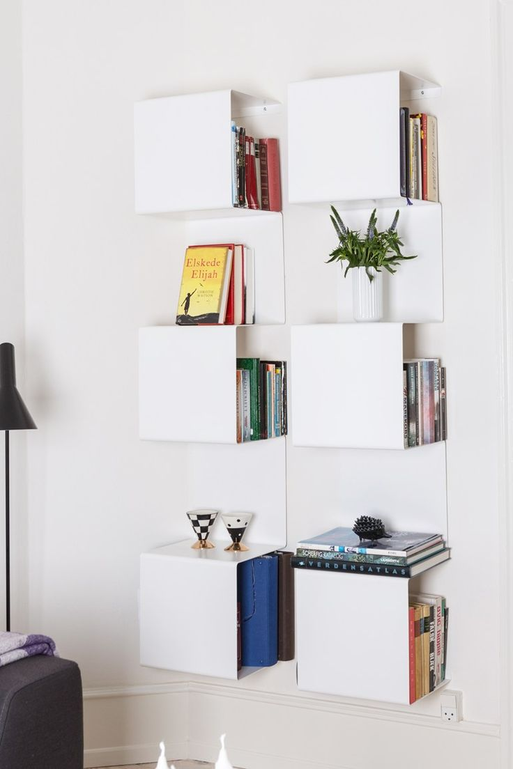 Wall-mounted powder coated aluminium bookcase SHOWCASE#1 by Anne Linde