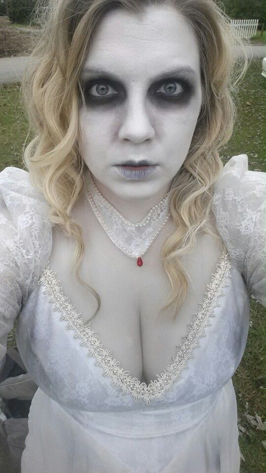 Ghost bride costume and makeup. Makeup used: mehron clown white for base, matte black eyeshadow, matte brown eyeshadow, black lipstick.