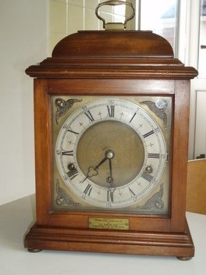 Hi,this is an Elliott of london westminster walnut bracket clock in working order and in fair condition with a square brass dial and brass handle to the top 13  tall to the top of the handle 9  wide