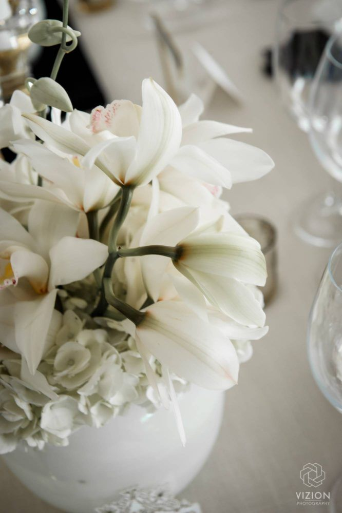 Elize & Stefan - Wedding Showcase | The Aleit Group  Wedding flowers. White lilly.Table decor. Laurent Venue. South Africa.