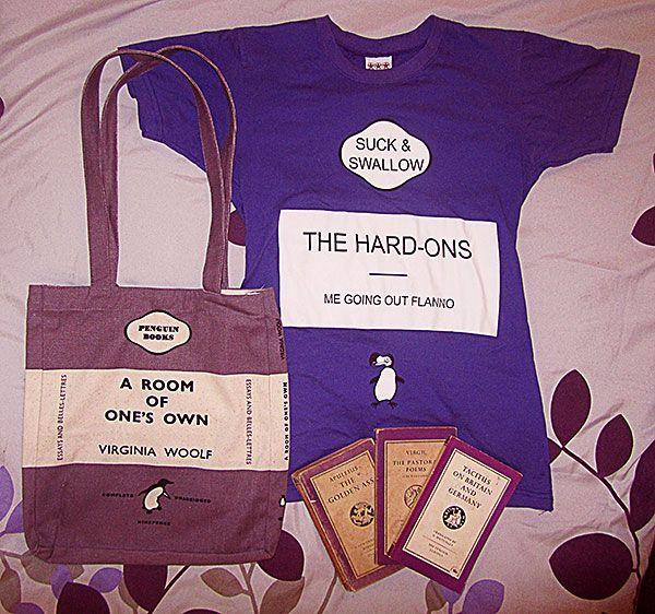I love reading... I love reading the classics... I love purple... I love Penguin Classics... I love Purple Penguin Classics...I love the Aussie band the Hard-Ons... I love Classic Hard-Ons songs, I love Modern Classic Hard-Ons songs... I love my special made, unique purple Penguin Classic inspired Hard-Ons t-shirt.  (I also have a purple Penguin Classic ceramic mug that didn't make it into the photo)