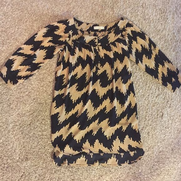 Black & Gold Chevron Top This top has never been worn and is in perfect condition! I would wear it with leggings but some may consider it a dress. Comes from a smoke free home! NWOT Giddy Up Glamour Tops