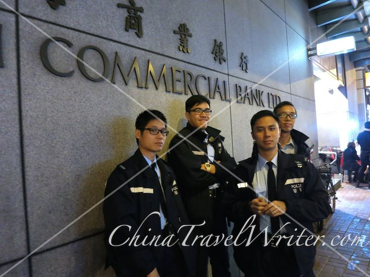 Police in #Mongkok wait for the night's demonstration outside a bank. #OccupyHK #OccupyMongkok #OccupyCentral