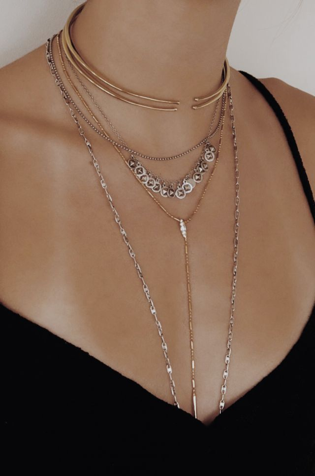 With the recent launch of her fall collection, abundant with a variety of layer-worthy chains, designer Amanda Thomas is dishing some of her essential tips on how to stack and mix her gorgeous charm necklaces, chokers, body chains and more. And ever wonder how to keep your delicate chains from