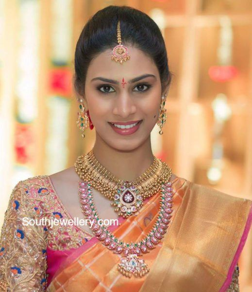 Bride in Antique Gold Necklace and Ruby Mango Mala