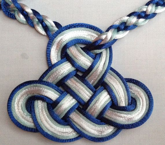 I love the combination of the trinity knot and the braid on this.