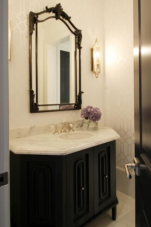 Elegant Black And White Powder Room Features Walls Clad In White And Taupe Trellis Wallpaper