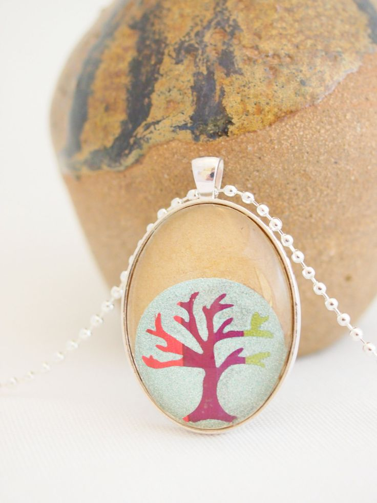 tree necklace, kraft paper, silver glitter, paper collage jewelry, silver oval pendant, tree of life - pinned by pin4etsy.com