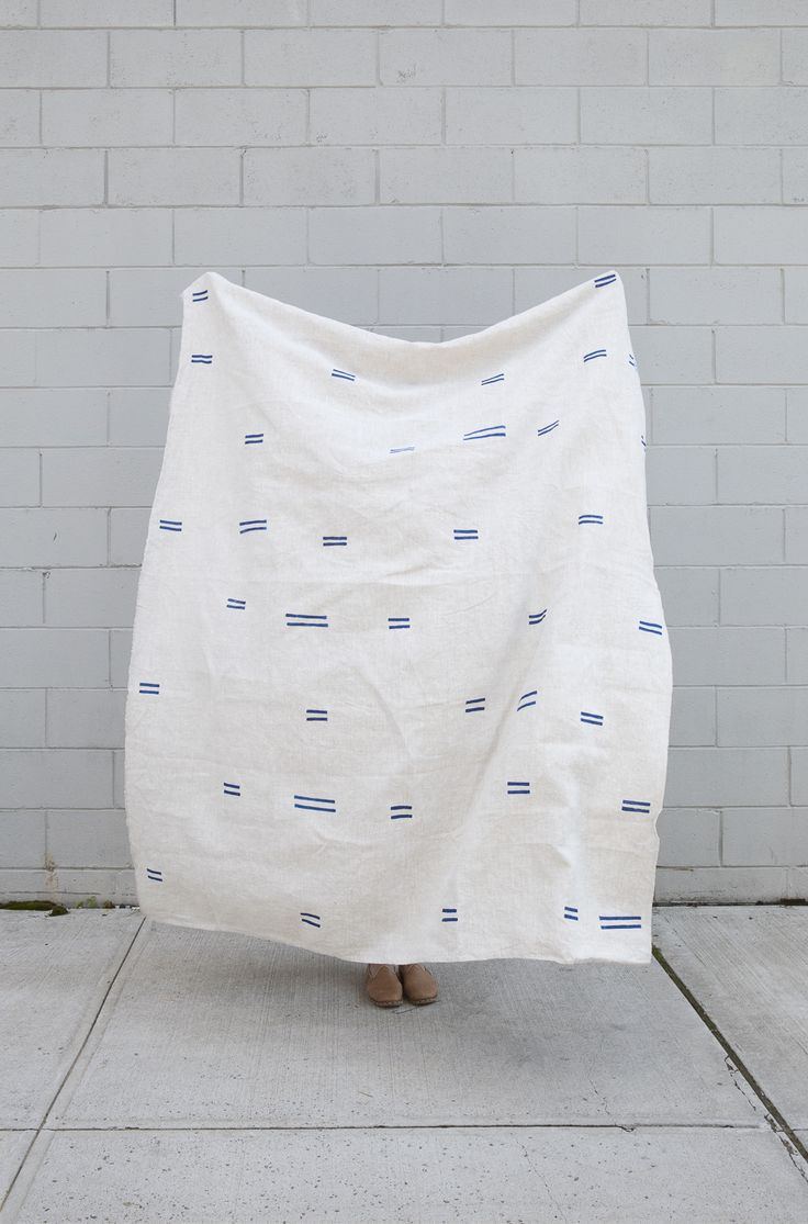 This linen throw is perfect for a table cloth, beach towel, couch throw,  wrap dress, or anything else you can think of. All of our throws are  individually block printed by hand with non-toxic acrylic ink. Each throw  is pre-washed and ready to be loved.     Details:  -100% linen  -measures approximately 74 x 56 inches  -proudly made by hand in the U.S.A.     Care Instructions:  -machine wash cold with like colors, tumble dry low heat