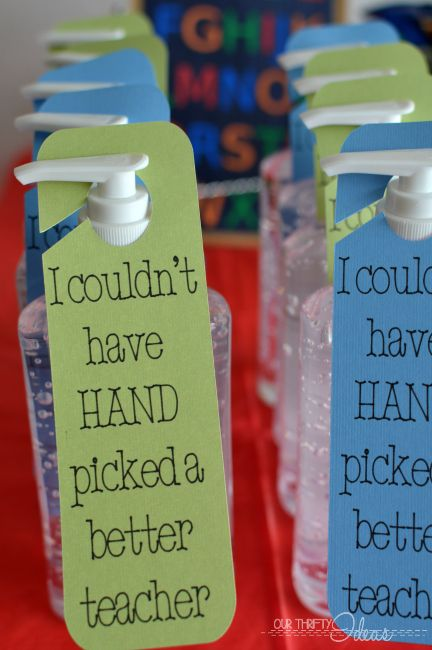 give the gift of sanitizer for back to school. Free Cricut cutting template for these hanging signs. The perfect gift for your kids to give their teacher.