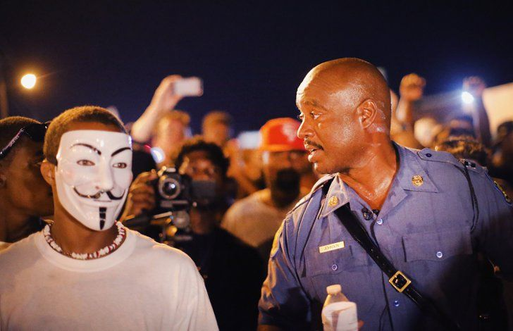 Pin for Later: 21 Powerful Images From the Ferguson Protests  Capt. Ronald Johnson of the Missouri State Highway Patrol walked among demonstrators during a peaceful protest.
