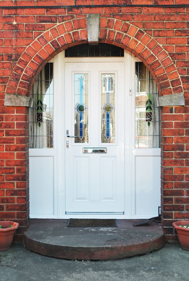 Stunning White Altmore Composite Door and windows with UPVC side panels and Rectangular lead and bespoke glass design throughout. Keeping Character and staying true to the design of your property can sometimes be the best way to enhance your home, modernizing an old period property can sometimes harm the style, character and beauty. We offer a wide range of styles, colors and bespoke stained glass style designs. #windows #compositedoors #frontdoor #stainedglass #door #periodstyle #property