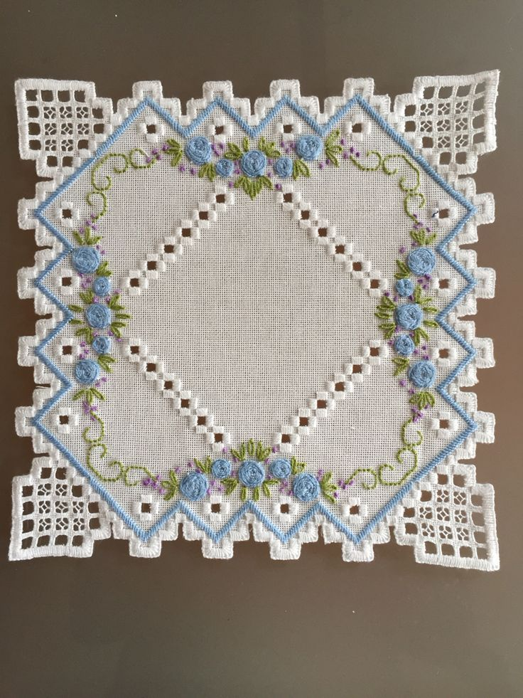 A beautiful hardanger drawn thread piece that looks like a garden.