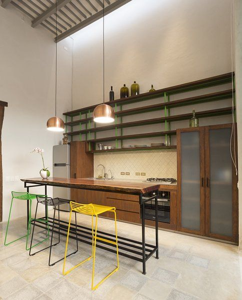 Modern home with kitchen, wood cabinet, engineered quartz counter, wood counter, ceramic tile backsplashe, pendant lighting, refrigerator, cooktops, and undermount sink. Tropical wood Tzalam add warm to the space. Photo 9 of Lemon Tree House