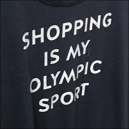 Olympian Class Shopping is not limited to Rio de Jareiro, or even Olympic Season for that matter. This T-Shirt says so with gusto and withno…