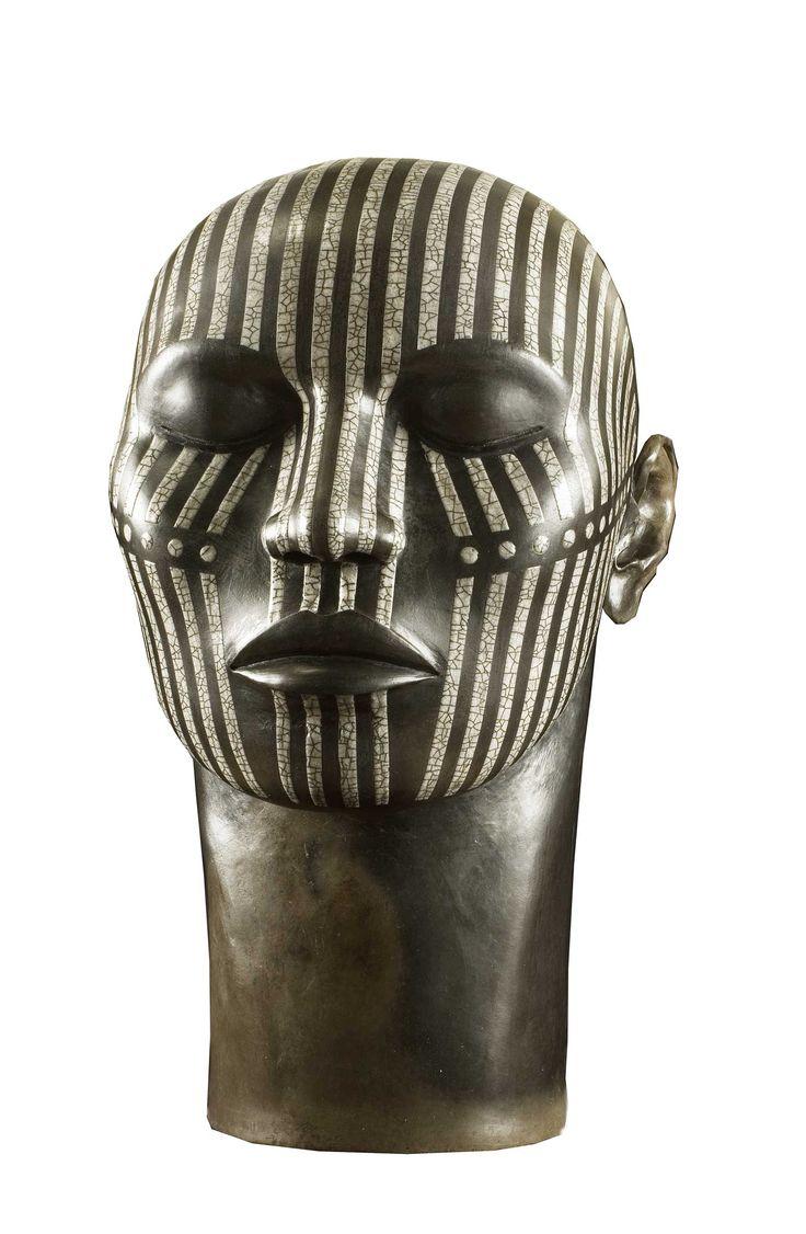 "<span class=\""artist\"">TRIBAL HEAD - Kikuyu</span><br />2010<br />Raku ceramic<br />height: 18.3 in<br />Price: € 1,200"