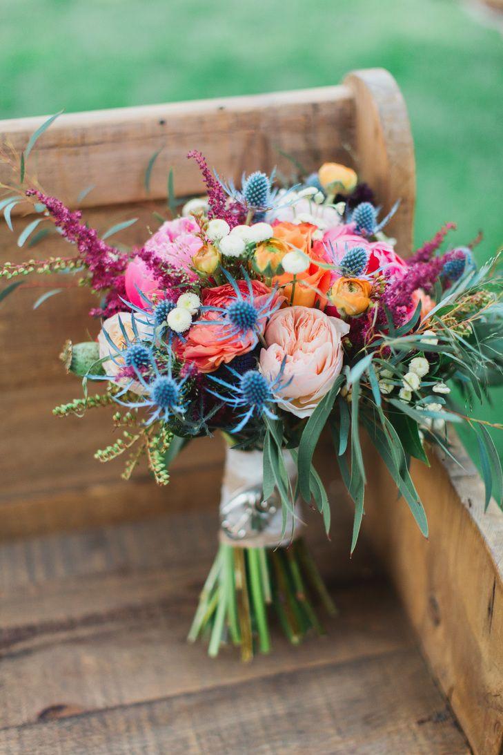Colorful Wild Bridal Bouquet With Messy Greens | J. Renee Studios https://www.theknot.com/marketplace/j-renee-studios-las-vegas-nv-870869 | Open Invitation https://www.theknot.com/marketplace/open-invitation-las-vegas-nv-662663 | Lush Floral
