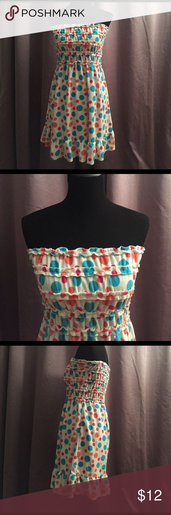 🥂SALE: $9🥂 Polka Dot Swimsuit Cover Up Super cute polka dot swimsuit cover up. White base with blue, peach and pink dots. Soft, terrycloth type material. In great condition. 🥂Sale pricing is firm. If you'd like to purchase, please submit $9 through the offer button and I will accept it. Charlotte Dresses