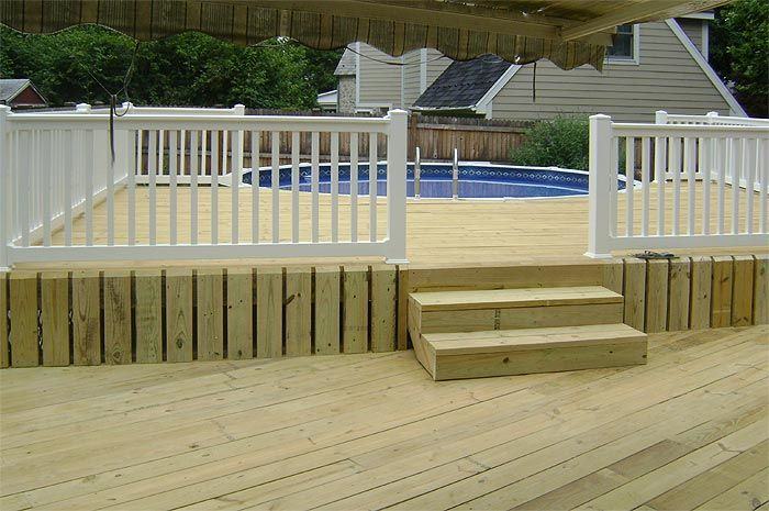 Pressure treated above ground pool deck with vinyl railing