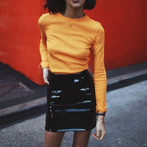 I love black pvc mini skirts and this colour block look.