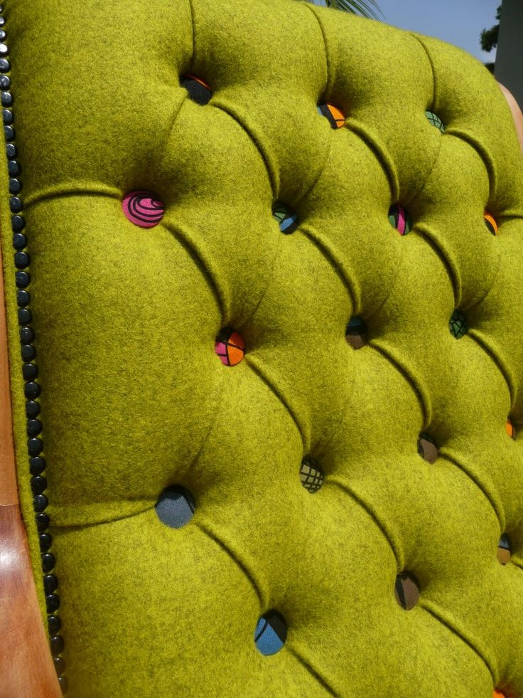 "I am not a ""lime"" girl - but I love the colored upholstery buttons and the over concept of taking traditional / retro furniture and giving it new life. This is a close up of a rocking chair."