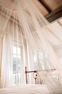 Single-point tulle or gauze canopies.  Shade structure.  Fabric, hula hoop, minimal sewing, rope.  Might be able to use weird old lacy table cloths.  Add Christmas lights for night.