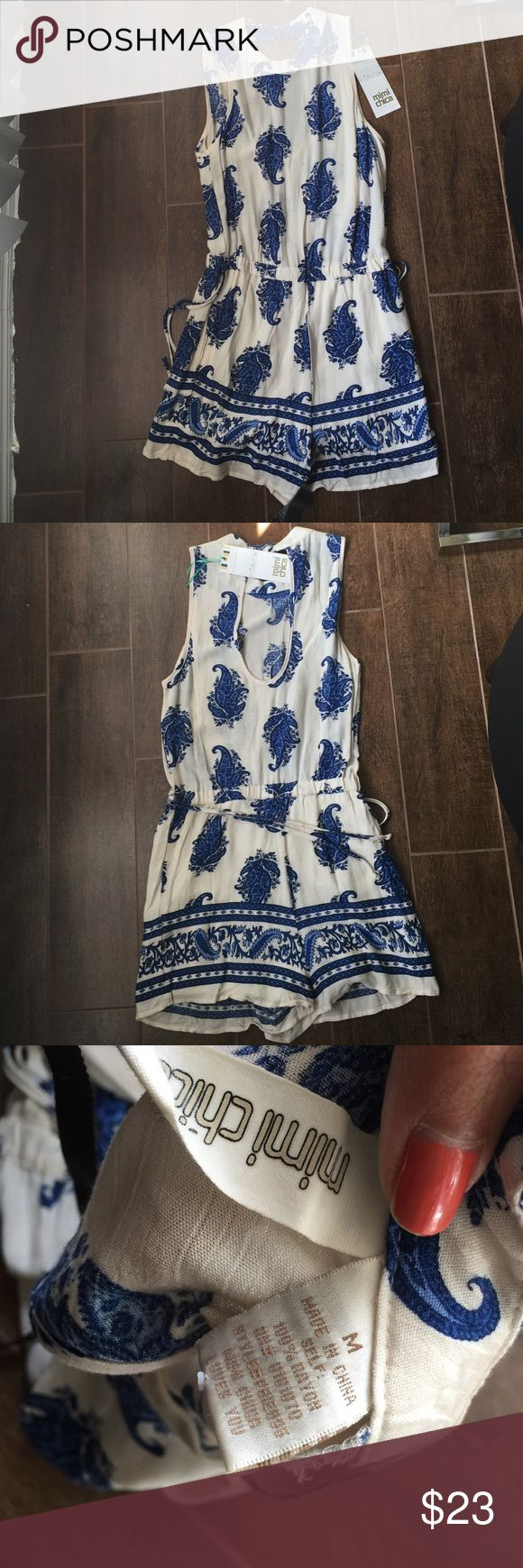 NWT MiMi Chica women's romper sz m NWT MiMi Chica women's cream color with blue floral printed shorts suit/romper sz medium. Never worn! Perfect for spring or summer wear. No rips tears or odor.  Please refer to pics for true detail description of the condition and please message me if you have any questions thank you and happy shopping! Mimi Chica Pants Jumpsuits & Rompers