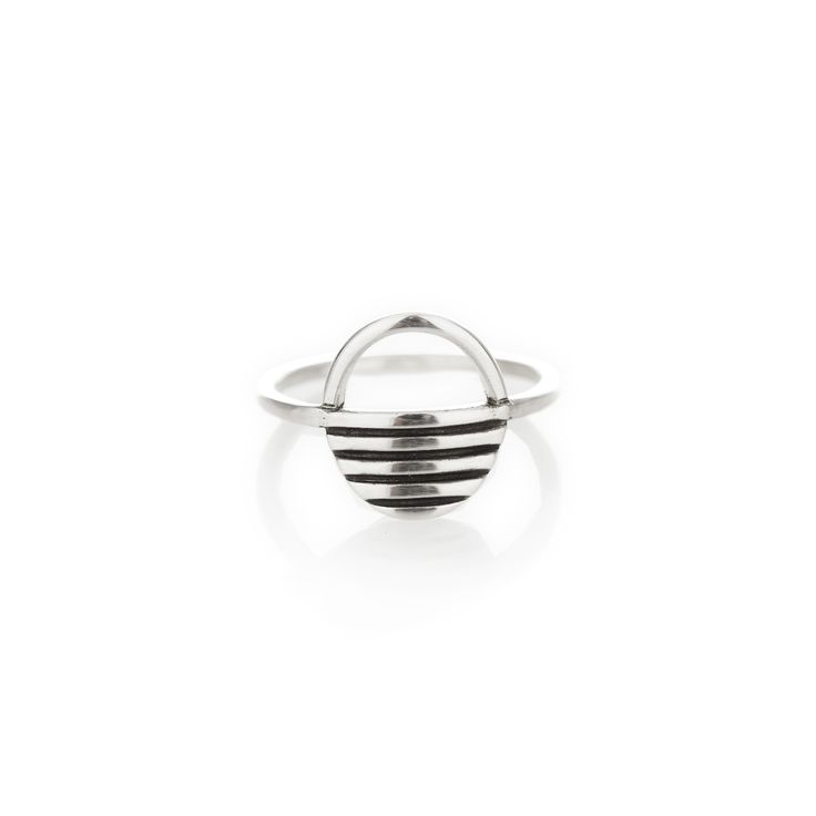 A thin rounded sterling silver band with a centred sunrise.  Please check our info page for more details on ring sizes.