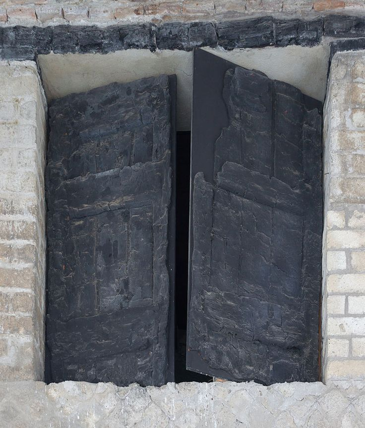Ancient roman burned wooden window shutters in Herculaneum, Italy.
