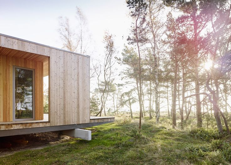 Timber summerhouse by Johan Sundberg takes in views