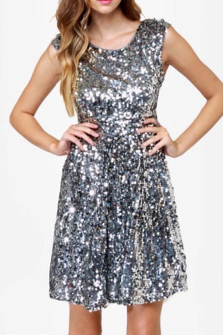 Sparkly mini dress covered in silver sequins, zipper closure with open back. Also has a petticoat lining for that extra flare.   Silver News-Flash Dress by Black. Clothing - Dresses - Holiday Clothing - Dresses - Cocktail Kansas