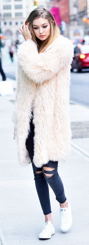 Faux fur coat with tshirt and high waisted black jeans.